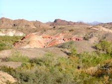 The green of the lower washes quickly changes to desert uplands.