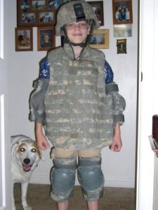 Son Nathan tries on dad's body armour.