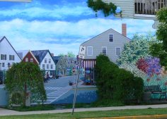 Some of the buildings have murals of the town's street scenes.