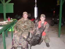 One of our disabled hunters, Pete, with his hog and his helper, Kurt.
