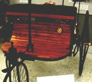 This is an 1887 Benz, 1 cylinder, 1 hp. carriage.