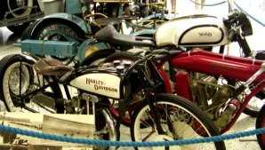 There are a number of early motorcycles on display.