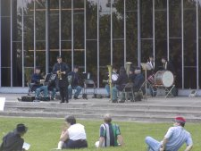 A band of re-enactors performs military music in the park.