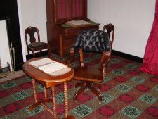 The actual table and chair used by Gen. Grant to sign the surrender.