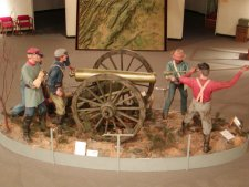 Field artillery in action display in the museum.